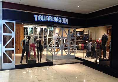 True Religion Brand Jeans storefront. Designer jeans in New York, NEW YORK