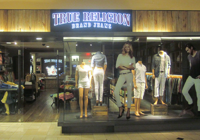 True Religion Brand Jeans storefront. Designer jeans in Garden City, NEW YORK